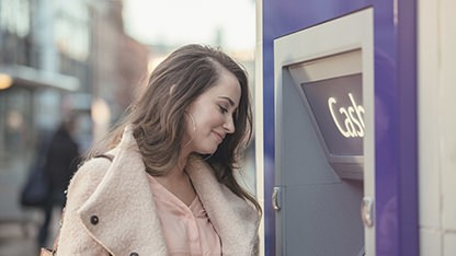 Woman at a cash machine
