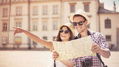 Couple smiling while looking at a map and pointing