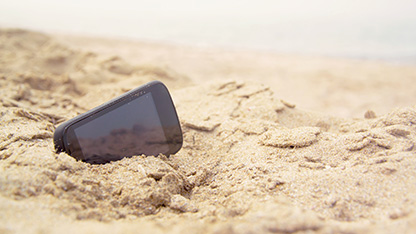 Mobile phone in the sand at a beach