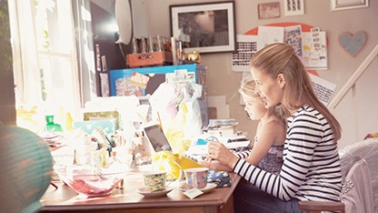 Mother & daughter working at desk