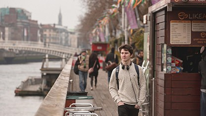Student walking down the Liffey