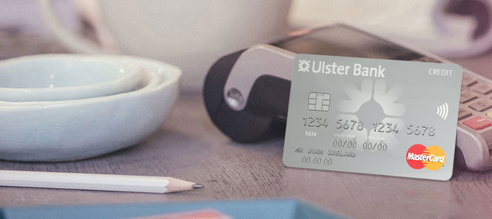 RI credit card beside a merchant terminal