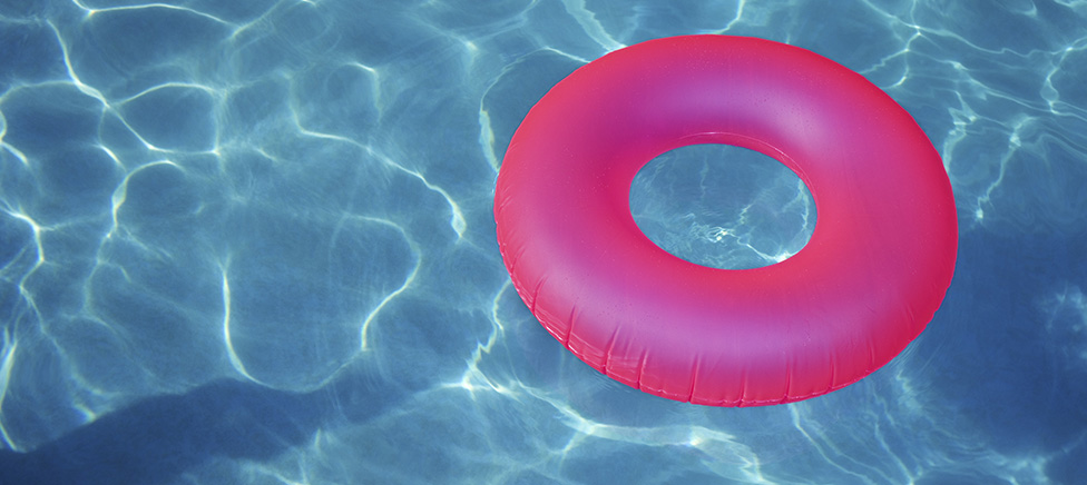 Azure pool with a fuchsia rubber ring - made possible by a holiday loan