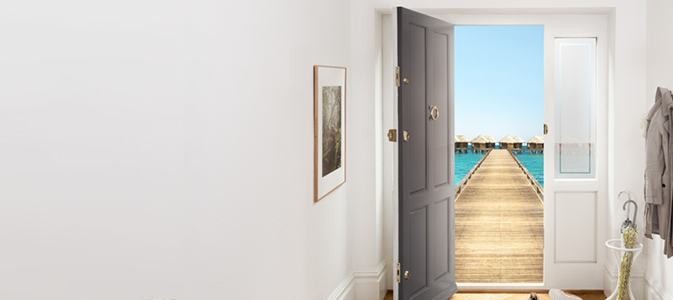 Front door opening to blue sea and pier