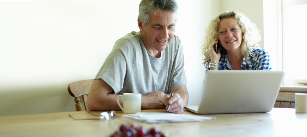 Couple reviewing finances at home