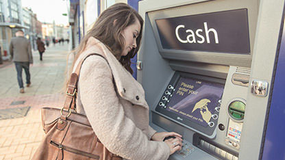 A woman at the cash machine